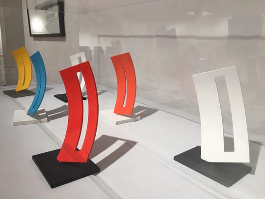 "A 14-foot high version of these diminutive models of ""Curved Form with Rectangle and Space"" stands between the Scarab Club and the Detroit Institute of Arts."