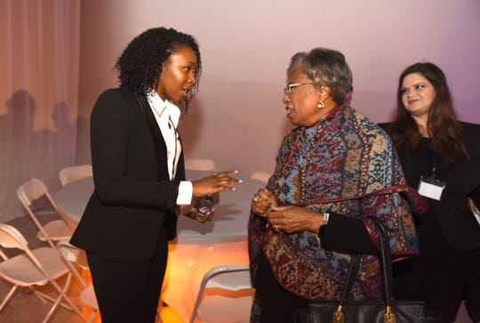 Lauren King, left, project engineer of the Cambria Hotel, speaks with Congresswoman Brenda Lawrence during the announcement of the construction of the hotel in downtown Detroit on Friday.
