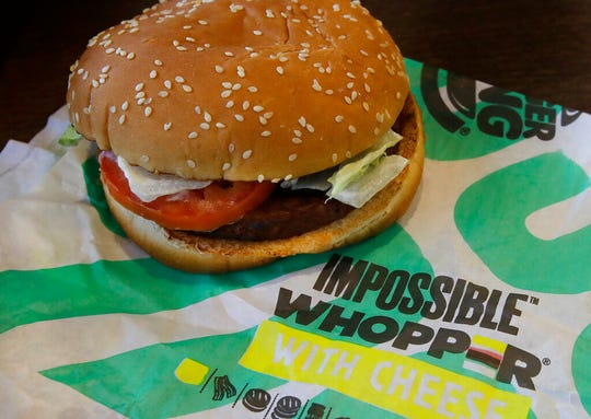 This July 31, 2019, file photo shows an Impossible Whopper burger at a Burger King restaurant in Alameda, Calif.