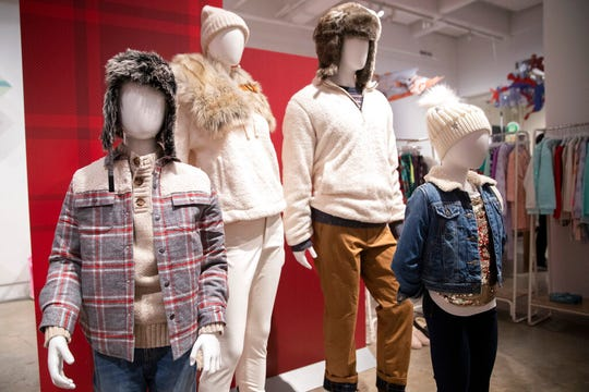 In this Wednesday, Oct. 23, 2019, photo clothing is displayed during a Target Holiday Outlook event in New York. Target Corp. says it's spending $50 million more on payroll during the fourth quarter than it did a year ago so that there'll be more workers on hand to help harried shoppers scrambling to get their shopping done in a shorter amount of time.