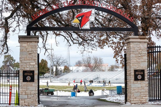 Fond du Lac High School staff, football players and other volunteers came together Thursday, October 31, 2019 to help clear several inches of snow off Fruth Field for Fridays Level two playoff game against Sun Prairie. Doug Raflik/USA TODAY NETWORK-Wisconsin