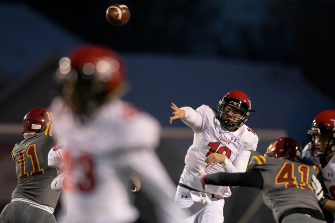Fairview High School senior quarterback Aidan Atkinson (10) passes during a game against Rocky Mountain High School on Thursday Oct. 31, 2019, at French Field in Fort Collins, Colo. Atkinson set the state record for passing yards in a career in the game.