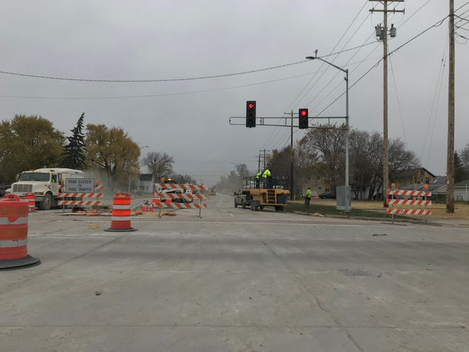 Construction crews put the finishing touches on the rebuilt section of Webster Avenue north of Main Street in Green Bay. The street will reopen to traffic on Monday