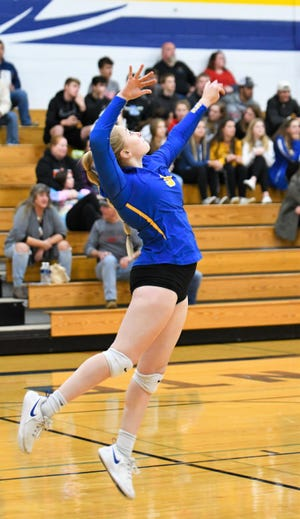 Emma Walkowiak Oconto serves up an ace in the second set against Oshkosh Lourdes in the sectional-semifnal match in Oconto on Thursday, Oct. 31.