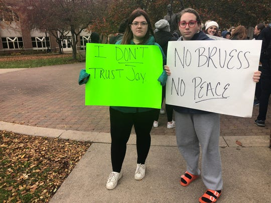 St. Norbert College students gather on campus to protest the announcement that President Brian Bruess will step down at the end of the school year.