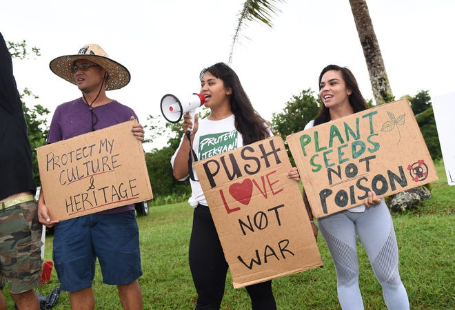 Prutehi Litekyan - Save Ritidian and its supporters stage a peaceful protest against the Department of Defense and the military buildup across from the Joint Region Marianas on Nimitz Hill in this Nov. 1, 2019, file photo.