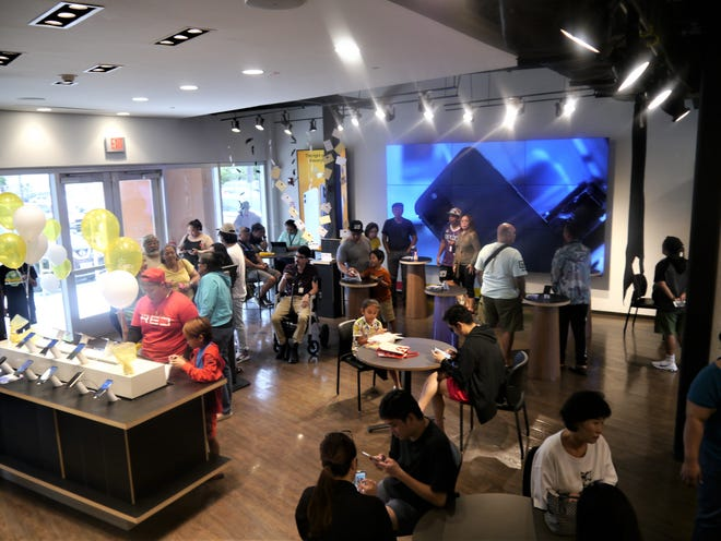 Customers at GTA's Experience Center cell phone store in the Camacho Landmark Center in Tamuning during the Guam launch of the iPhone 11 Nov. 1.