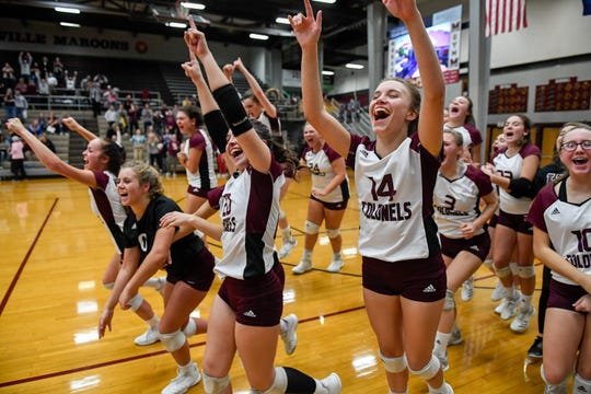 The Lady Colonels run to receive their regional championship trophy as Henderson County defeats the University Heights Lady Blazers for the Second Region volleyball tournament championship at Madisonville-North Hopkins High School Thursday evening, October 31, 2019.