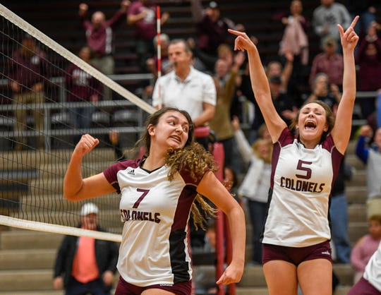 Henderson's Kaylee Stott (7) and Asha Nalley (5) react after the winning match point as the Henderson County Lady Colonels play the University Heights Lady Blazers for the Second Region volleyball tournament championship at Madisonville-North Hopkins High School Thursday evening, October 31, 2019.