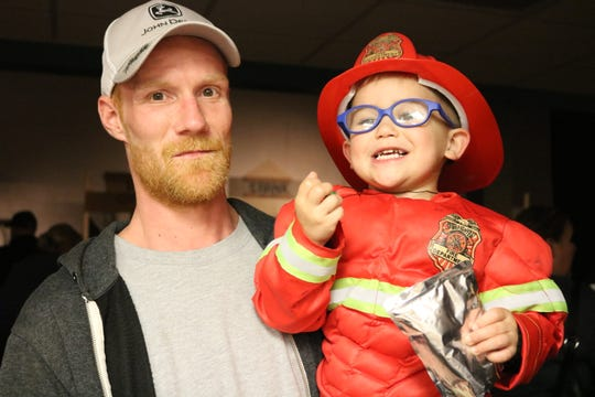 """Firefighter"" Kayden Stone was hanging out with Timothy Walters seen here at the Halloween event."