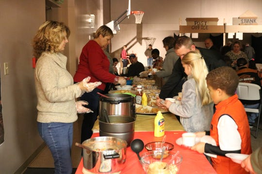 Soups, chili, hot dogs, and cookies were just some of the food served at the annual Halloween night event at GFC.