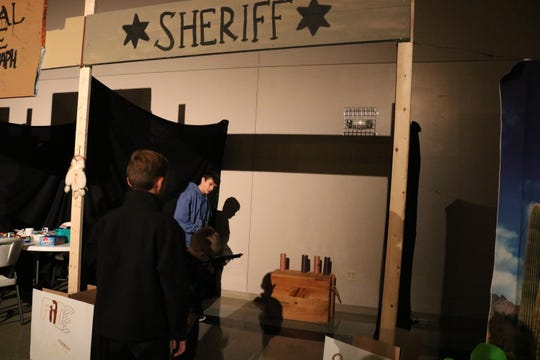 Luke Beauchamp helped with the Sheriff booth at the Western-themed Halloween night event at Grace Fellowship Church in Morganfield.
