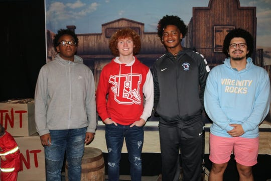 Several high schoolers came out to help at the annual event. These four posed in front of the Western town banner in the Grace Fellowship Church annex building. Pictured here are: Andre Elam, Justin Linkswiler, Iverson King, and Tommy Ariza.