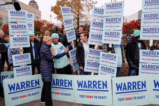 Democratic presidential candidate Sen. Elizabeth Warren, D-Mass. greets supporters gathered before the the Liberty and Justice Celebration Friday, Nov. 1, 2019.