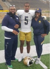 Notre Dame senior cornerback Troy Pride Jr. with his parents Angela and Troy Pride Sr.