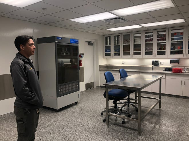 Clayton Schuneman, Johnson County Medical Examiner administrative director, describes investigative procedures at the department facilities Oct. 31, 2019, in Iowa City.