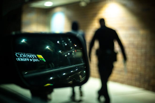 Iowa City police officer Tyler LaKose leads a suspect into the Johnson County jail, Friday, Nov., 1, 2019, in Iowa City, Iowa.