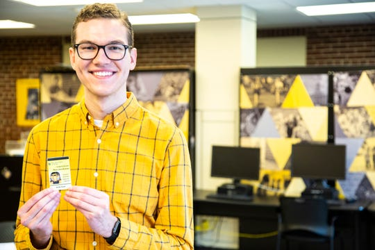 University of Iowa junior Connor Wooff poses for a photo with a new temporary Iowa One Card, Friday, Nov., 1, 2019, at the Iowa Memorial Union on the University of Iowa campus in Iowa City, Iowa. The One Card is the photo identification card for University of Iowa students.