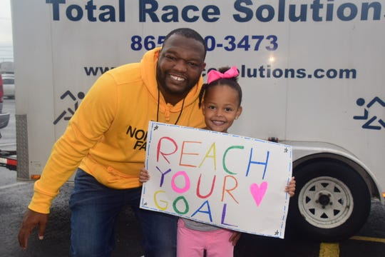 Michael Floyd and Piper Floyd cheer on mom Jasmine Floyd. The goal is to finish well and finish safely at the inaugural Ram Run 5K held at Grace Christian Academy Saturday, Oct. 26.