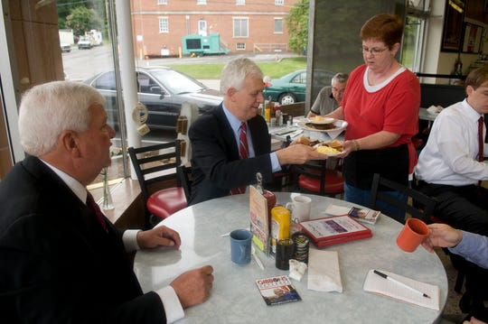 Jeannie McDaniel, a waitress at Long's Drug Store, brings breakfast plates for Shelby County D.A. and Republican candidate for governor Bill Gibbons, center, and Knox County District Attorney General Randy Nichols on July 23, 2009.