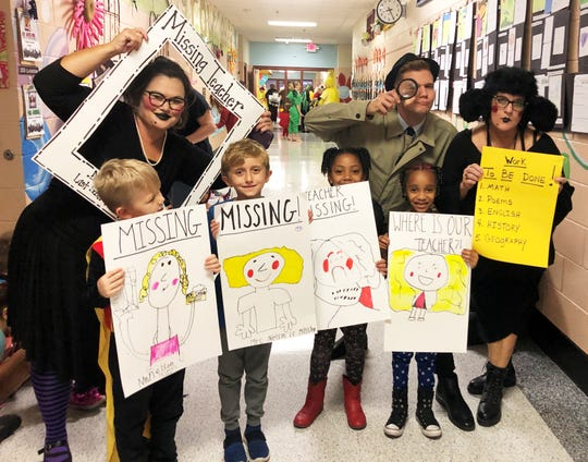 "First grade turned into sleuths to solve the mystery in ""Miss Nelson is Missing"" during the Dogwood Elementary School storybook character parade on Oct. 31. Pictured back row: Scarlett Hopkins, intern Jake Allbright and Angela Velazquez. Front row: Jayden Lavato, Tre Garner, Aneriah Summers, Celeeah Anderson. 10/19"