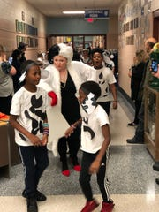"Dogwood Elementary School fourth grade teacher Kim McDaniel with  her ""101 Dalmations"" pictured here with Rondell North and Marquis George on Oct. 31."