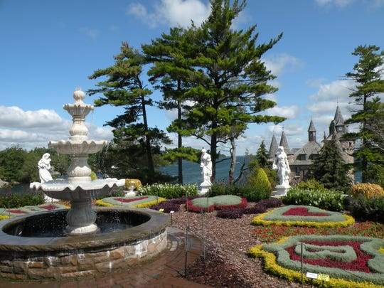 Statues enliven a garden at Boldt Castle on the St. Lawrence River. More than 20,000 plants populate the island's numerous gardens.