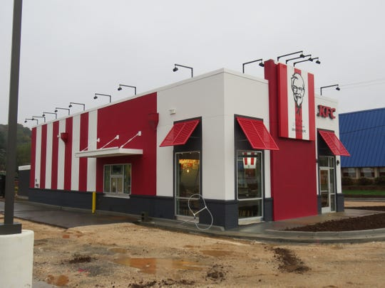 The under-construction Kingston Pike KFC featuring the traditional red and white stripes is shown on Oct. 30.