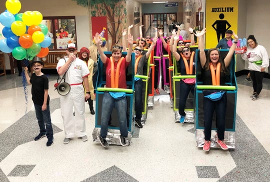 Fifth grade and special education teachers rode their rollercoaster through the school hallways during the Dogwood Elementary School storybook character parade. They took the grand prize.