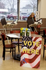 Pauline Rohr of Lafayette casts her ballot at a voting center inside Pay Less Super Market, 2513 Maple Point drive, Thursday, Oct. 31, 2019, in Lafayette.