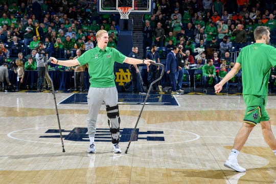 Notre Dame guard Rex Pflueger watched warmups on Jan. 26, 2019. His mother, Rebecca Pflueger, was diagnosed with cancer that month,  shortly after Rex underwent season-ending surgery to repair a torn ACL. Rebecca Pflueger died Sept. 14, and remains an inspiration to her son and his team.