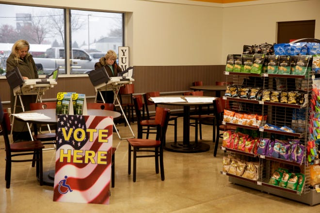 Voters cast their ballots at a voting center inside Pay Less Super Market, 2513 Maple Point drive, Thursday, Oct. 31, 2019, in Lafayette.