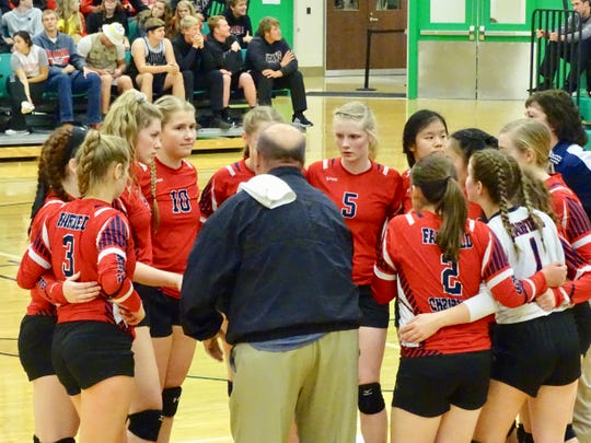 Fairfield Christian Academy coach Jeff Eversole talks with his team during a break in the action during Thursday's Division IV regional semifinal game against Fort Loramie.