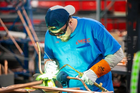 Welding technician Zackary Ludwick works on the floor at Kentuckiana Curb Co., which is making a $50 million investment in a new facility on Blankenbaker Lane in Louisville and adding 400 jobs.
