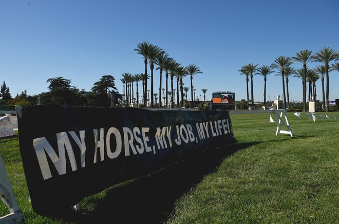 General view of signage outside Santa Anita Park before the 36th Breeders' Cup in Santa Anita, California, on Friday,