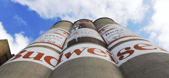 The well-known Budweiser art on the Briess Malt & Ingredients Co. malt towers as seen, Tuesday, October 29, 2019, in Manitowoc, Wis.