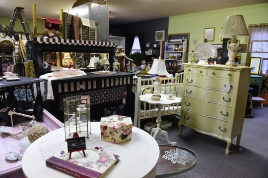 Antiques of all types can be found inside Petit Tresor Boutique on South Main Street in Mansfield.