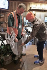 Hunt master John Hopper shows Carson Huff the proper place to shoot a deer during a Tennessee Wildlife Foundation hunting academy workshop.