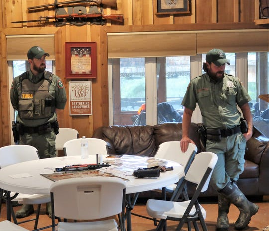 Tennessee Wildlife Resources Agency conservation officers Matt Canada, left, and John Dunn lead a discussion during a Tennessee Wildlife Federation hunting and fishing academy.