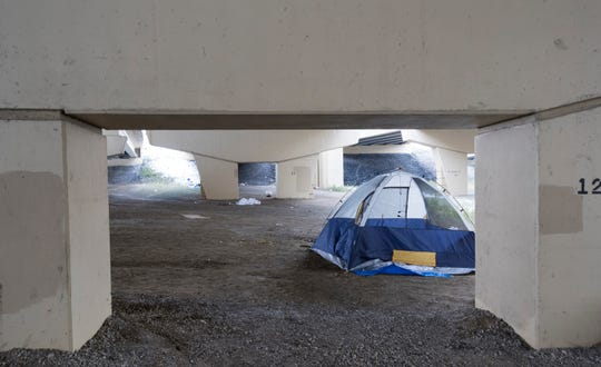 "One of a handful of tents is shown Friday underneath the Marquette Interchange near North 11th Street and West St. Paul Avenue in Milwaukee. All but a handful of people living in the downtown Milwaukee homeless encampment known as ""Tent City"" are gone after having been ordered to leave the encampment by Oct. 31."