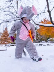 Three-year-old Clara Proefrock of Cedarburg frolics in the snow during the annual Cedarburg Pumpkin Walk on Oct. 31. A Halloween snowstorm blanketed southeastern Wisconsin with a wet, slushy snow.