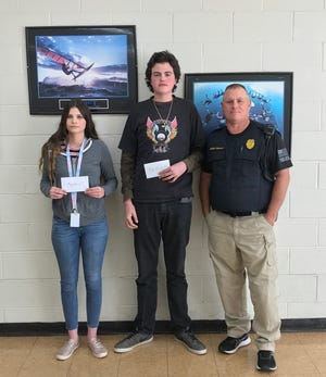 The Guy Berry College & Career Academy winners of the 2019-2020 Elks Drug Awareness Essay Contest were recently honored at an awards assembly. The top three winners were awarded checks from the Mountain Home Elks Lodge. Pictured are: (from left) Savannah Smith, first place; Colton Smith, thirdplace; and School Resource Officer Eddie Helmert. Not pictured: Katelynn Mooney, secondplace.