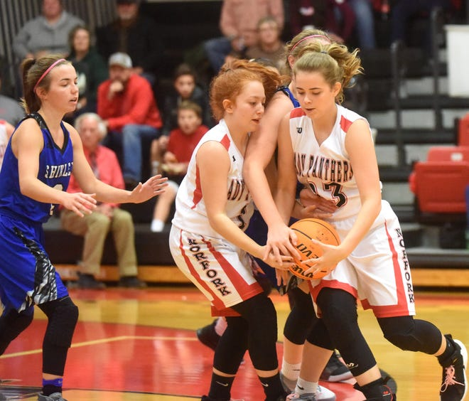 Norfork's Kylie Manes takes a hand-off from Madison Hall away from a Shirley defender during the Lady Panthers' 46-39 victory on Thursday night.