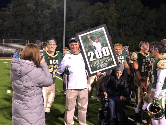 OCS head coach Stevn Fitzhugh was presented with a picture commemorating his 200th win following a 41-0 victory over St. Frederick on Thursday night.