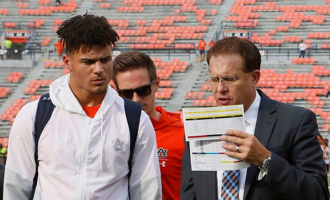Auburn coach Gus Malzahn (right) speaks to quarterback Joey Gatewood (left) before a game at Jordan-Hare Stadium.