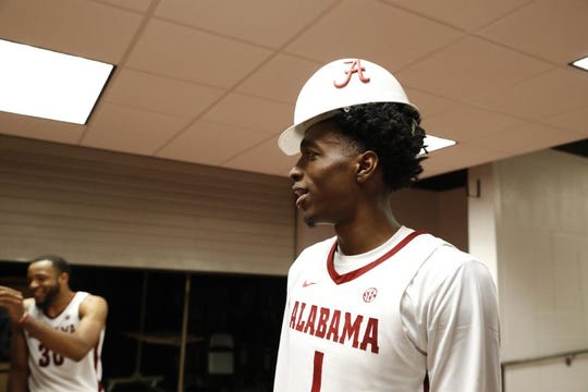 "Alabama junior wing Herbert Jones sports the team's ""Hart Hat"" award presented to the player with the most ""blue-collar points"" in a game. Jones received it following the Crimson Tide's 93-65 win over Georgia Tech in an exhibition game Oct. 27, 2019 in Coleman Coliseum. (Photo courtesy of Alabama athletics)"