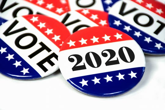 close up of political voting pins for 2020 election on white