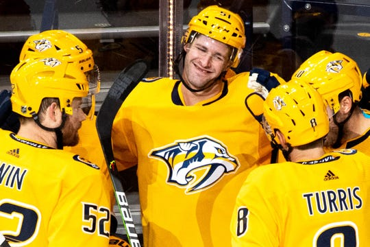 Nashville Predators left wing Austin Watson (51) celebrates his goal with teammates during the first period at Bridgestone Arena Thursday, Oct. 31, 2019 in Nashville, Tenn.