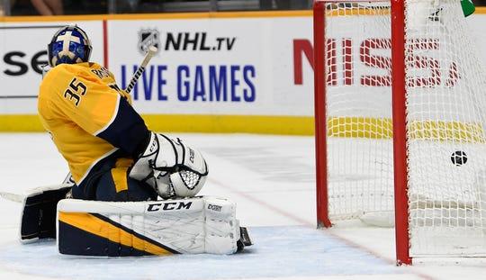 Nashville Predators goaltender Pekka Rinne (35) watches as the game winning goal by Calgary Flames left wing Matthew Tkachuk slips past during overtime on Thursday.