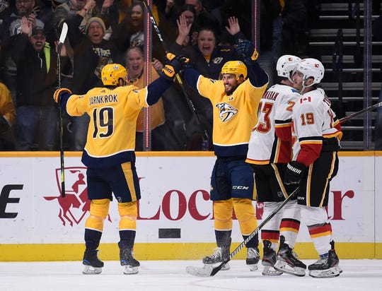 Nashville Predators center Calle Jarnkrok (19) is congratulated by defenseman Roman Josi (59) after his shorthanded goal against the Calgary Flames during the second period at Bridgestone Arena on Thursday.